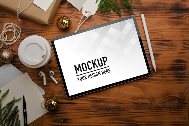 Top view of mockup tablet accessories and decorations on rustic table clipping path