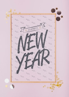Top view new year lettering on minimal golden frame
