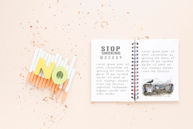 Top view notebook and cigarettes mock-up