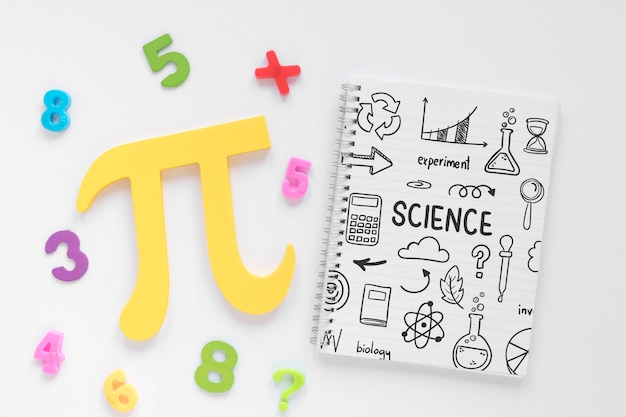 Top view of notebook with pi sign