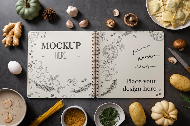 Top view of notebook with vegetables and food