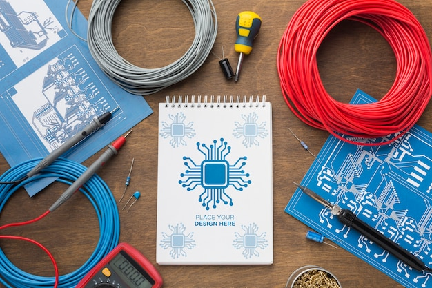 Top view notepad with electronics tools