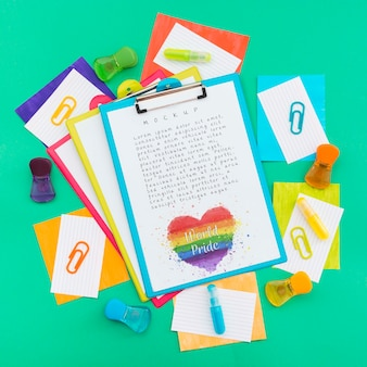 Top view of notepads with rainbow colored papers for lgbt pride