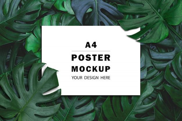 Вид сверху бумажного макета с зелеными листьями