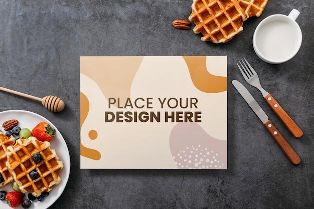 ペストリーの近くの料理本のモックアップデザインの上面図