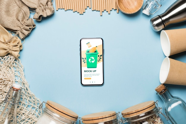Top view of paper cups and zero waste items with smartphone