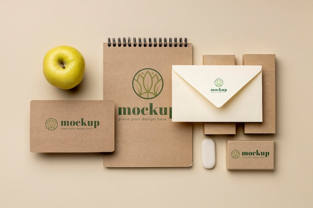 Top view of paper stationery with apple fruit