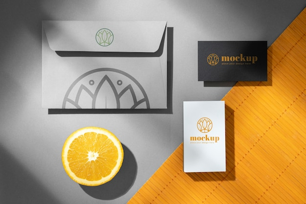 Top view of paper stationery with citrus fruit
