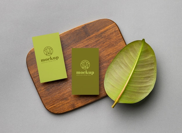 Top view of paper stationery with leaves Free Psd