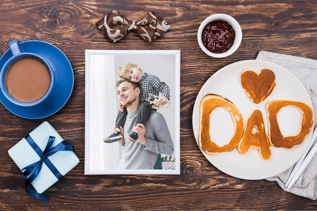 Top view of photo with coffee and gift for fathers day