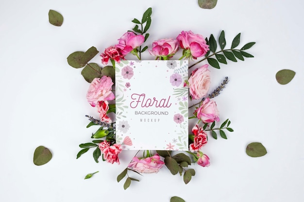 Top view pink roses and leaves framing mockup