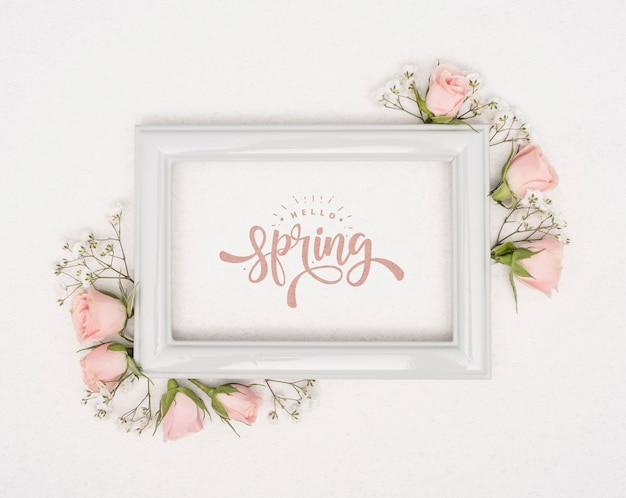 Top view of pink spring roses with frame