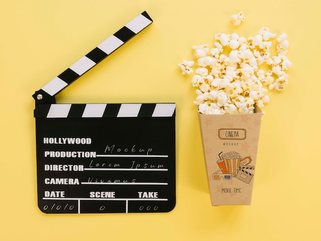 Top view of popcorn cup with clapperboard
