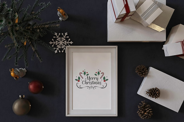 Top view of poster frame mockup with christmas tree, decoration and presents