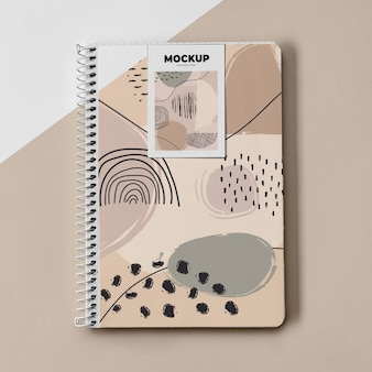 Top view poster mockup and notebook