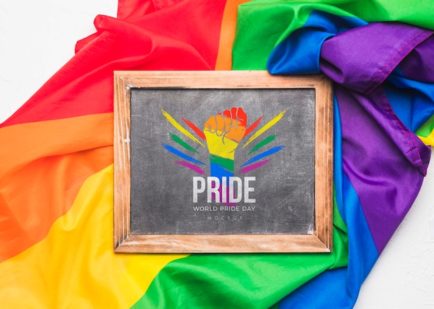 Top view of rainbow colored textile with blackboard for pride