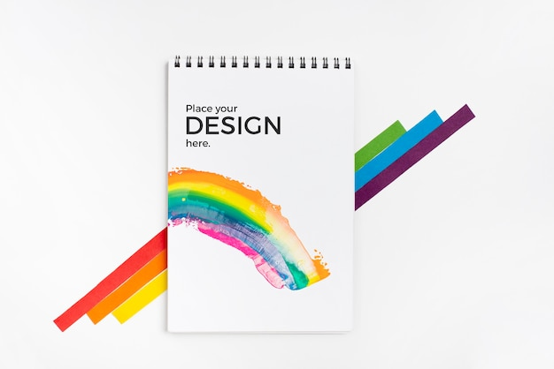Top view of rainbow colors with notebook