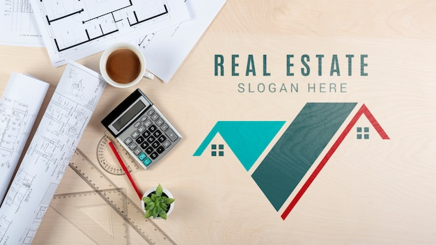 Top view real estate design with stationery items