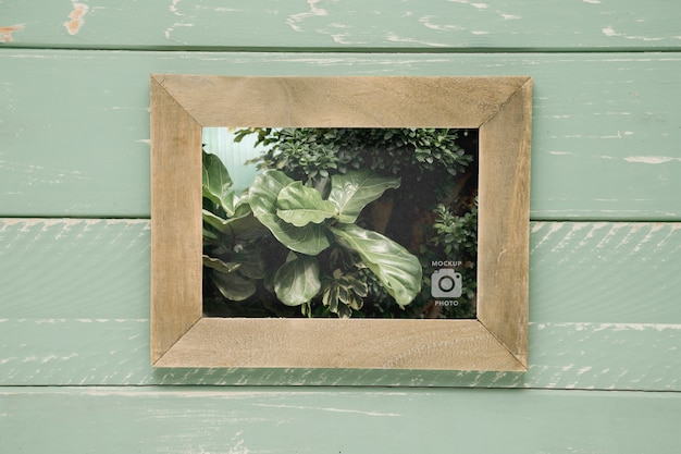 Top view of rectangular frame on wooden background