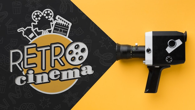 Top view retro cinema doodles and old camera