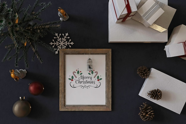 Top view of rustic poster frame mockup with christmas tree, decoration and presents