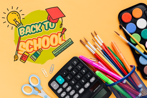 Top view school supplies with orange background