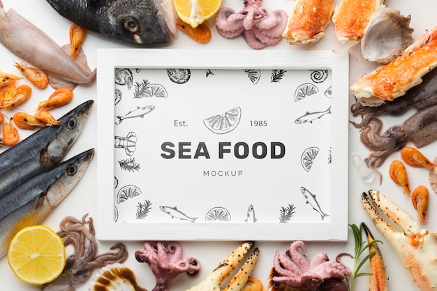 Top view sea food arrangement with frame mock-up