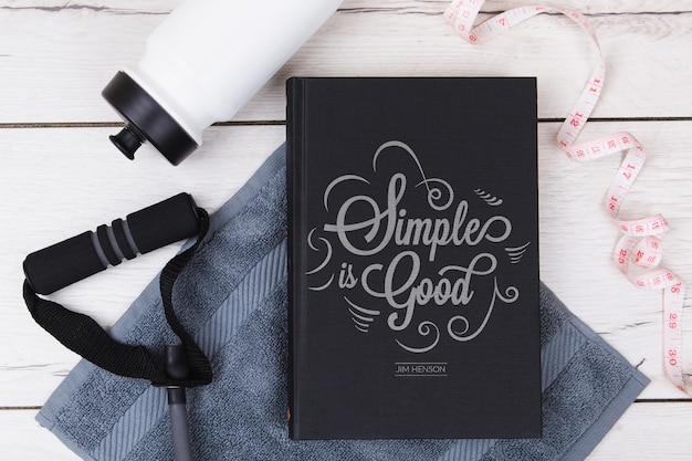 Top view simple is good quote book with fitness accessories