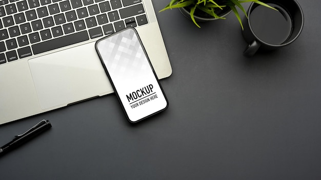 Top view of simple workspace with smartphone mockup