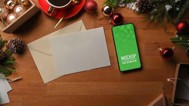Top view of smartphone mockup and christmas decorations