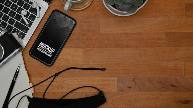 Top view on smartphone mockup on worktable