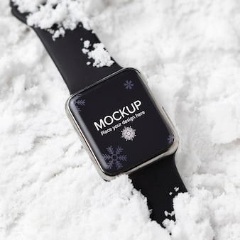 Top view smartwatch in snow