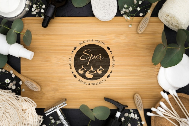 Top view spa center mock-up with accessories and leaves