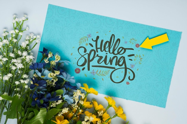 Top view of spring flowers with card