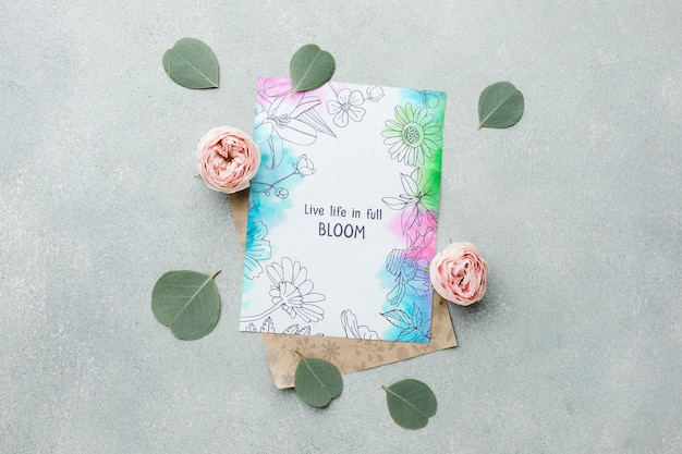 Top view of spring roses with card and leaves