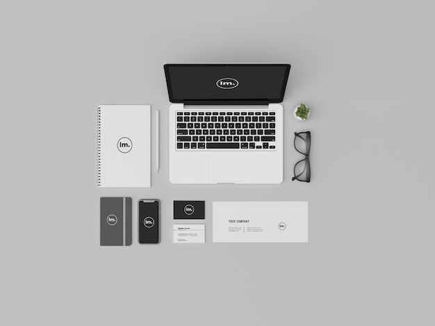 Top view and stationary mockup design with laptop