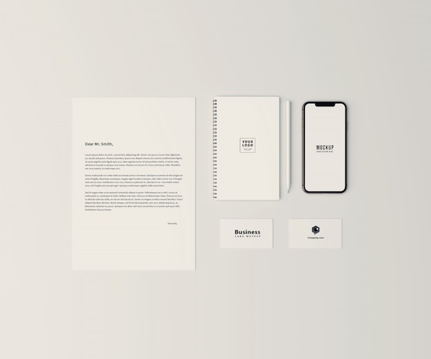 Top view stationary mockup with mobile phone