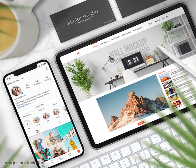 Top view stationery concept with tablet and phone mockup on marble table