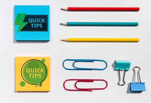 Top view sticky-notes and pencils knolling desk concept