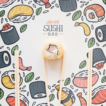 Top view of sushi and chopsticks on colorful background