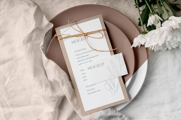 Top view of table arrangement with flowers and spring menu mock-up