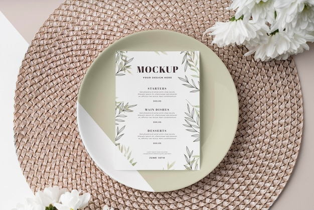 Top view of table arrangement with plate and spring menu mock-up