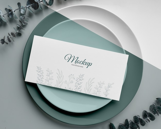 Top view of table arrangement with plates and spring menu mock-up