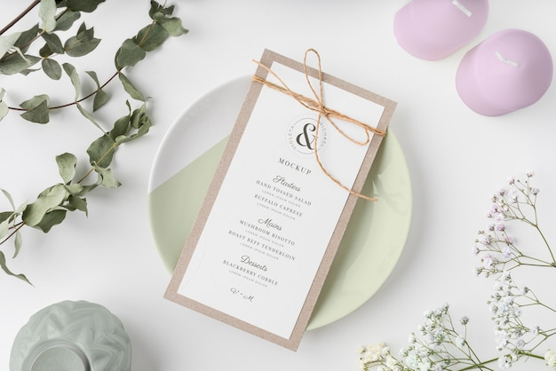 Top view of table arrangement with spring menu mock-up and candles