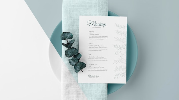 Top view of table arrangement with spring menu mock-up and leaves