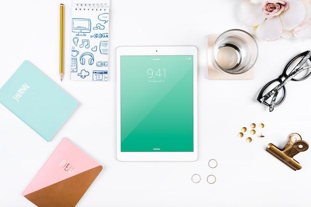 Top view tablet mockup on workspace