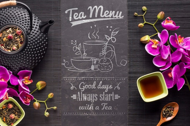 Top view tea menu with herbs and flowers