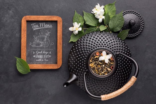 Top view tea pot with spices and tea menu