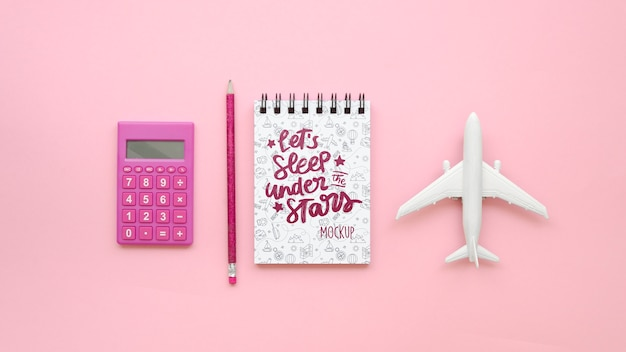 Top view travelling plane and pink calculator