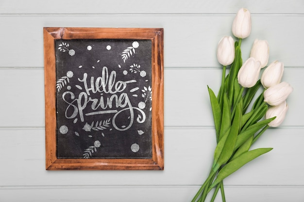 Top view of tulips bouquet with blackboard